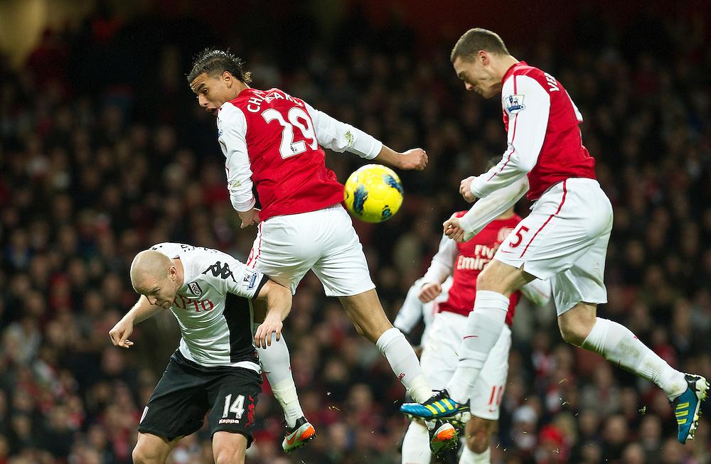 Arsenal's Thomas Vermaelen (right) scores alongside team mate Arsenal's Marouane Chamakh and Fulham's Philippe Senderos during  their English Premier League soccer match at the  Emirates stadium in London, Saturday, Nov. 26, 2011. (AP Photo/Bogdan Maran)