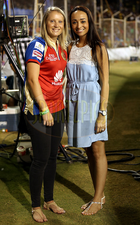Alysa Healy fiance of  Royal Challengers Bangalore player Mitchell Starc (l) and Chene Wiese wife of  Royal Challengers Bangalore player David Wiese(R) during match 22 of the Pepsi IPL 2015 (Indian Premier League) between The Rajasthan Royals and The Royal Challengers Bangalore held at the Sardar Patel Stadium in Ahmedabad , India on the 24th April 2015.<br /> <br /> Photo by:  Sandeep Shetty / SPORTZPICS / IPL