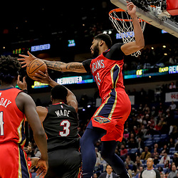 Dec 16, 2018; New Orleans, LA, USA; New Orleans Pelicans forward Anthony Davis (23) blocks a shot by Miami Heat guard Dwyane Wade (3) during the first half at the Smoothie King Center. Mandatory Credit: Derick E. Hingle-USA TODAY Sports