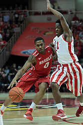 15 February 2014:  Ka'Darryl Bell drives past the point line against Paris Lee during an NCAA Missouri Valley Conference (MVC) mens basketball game between the Bradley Braves and the Illinois State Redbirds  in Redbird Arena, Normal IL.
