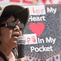 040415      Cayla Nimmo<br /> <br /> Jennifer Denetdale, a history professor from University of New Mexico, talks about colonialism leading to present day systemic racism in Gallup and other border towns at the demonstration held at the Gallup Chamber of Commerce Saturday.