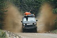 VW Syncro van driving really fast through mud puddles near Mt Rainier, WA.