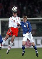 26/03/2005 WARSAW POLAND<br /> 26/03/2005 POLAND v AZERBAIJAN World Cup 2006 Qualifying Group 6 <br /> TOMASZ KLOS /2 POLAND L/ & DANIEL ACHTIAMOW /17 AZERBAIJAN R/<br /> FOT: PIOTR HAWALEJ /Digitalsport
