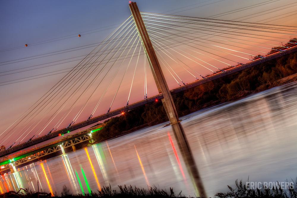 The Kit Bond Bridge over the Missouri River at Kansas City MO at sunset.