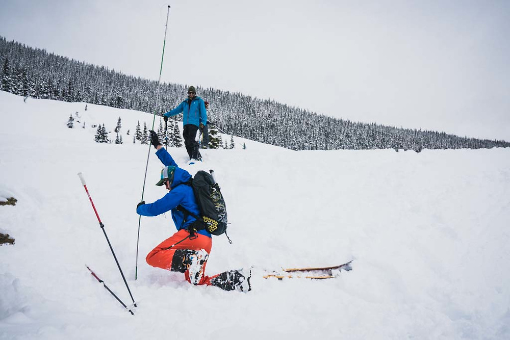 Joe Morabito executes an avalanche drill, Burnie Glacier Chalet, Howson Range, British Columbia.