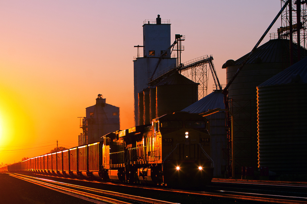 Coming out of a bright and colorful sunset, yet another of the many Union Pacific coal trains on their quadruple track mainline through Hershey, Nebraska, rolls toward North Platte and a crew change.