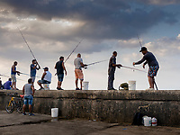Fishermen at the Malecon in the evening. Havana 2020.