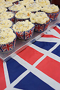 Cup cakes displayed on Union Jack table cloth at a neighbourhood street party in Dulwich, south London celebrating the Diamond Jubilee of Queen Elizabeth. A few months before the Olympics come to London, a multi-cultural UK is gearing up for a weekend and summer of pomp and patriotic fervour as their monarch celebrates 60 years on the throne and across Britain, flags and Union Jack bunting adorn towns and villages.