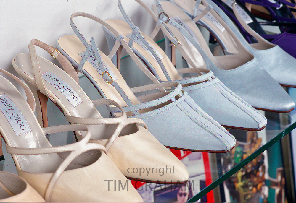 Shoes designed by Jimmy Choo on a rack in his showroom.
