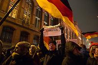 """05 JAN 2015, BERLIN/GERMANY:<br /> Demonstrant mit einem Blatt Papier, auf dem steht """"Freiheit für Christen"""", Bärgida-Demo """"Berliner Patrioten gegen die Islamisierung des Abendlandes"""", Spandauer Strasse<br /> IMAGE: 20150105-01-033<br /> KEYWORDS: Bärgida, Demonstranten, Protest, Demonstration,"""