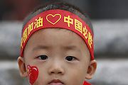 8/11/08 8:28:46 AM -- The 2008 Beijing Summer Olympics -- Beijing, China<br />  -- Beijing's Hutong neighborhoods were once for the wealthy and are now for all social classes and a disappearing tradition. Deng Yixuam, 1 shows his love for China in the Houhai bar district.<br /> <br /> Photo by Jeff Swinger, USA TODAY Staff