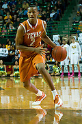 WACO, TX - JANUARY 25: Demarcus Holland #2 of the Texas Longhorns brings the ball up court against the Baylor Bears on January 25, 2014 at the Ferrell Center in Waco, Texas.  (Photo by Cooper Neill/Getty Images) *** Local Caption *** Demarcus Holland