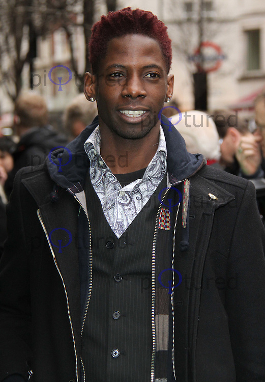 John Adeleye; The X Factor Yogi Bear - Gala Screening, Vue Cinema, Leicester Square, London, UK, 06 February 2011: Contact: Ian@Piqtured.com +44(0)791 626 2580 (Picture by Richard Goldschmidt)