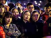 22 DECEMBER 2017 - HANOI, VIETNAM: Catholic nuns in the crowd watch the Christmas show at St. Joseph's Cathedral in Hanoi. There are about 5.6 million Catholics in Vietnam. The Cathedral was one of the first structures built by the French during the colonial era and was opened in 1886. It's one of the most popular tourist attractions in Hanoi.    PHOTO BY JACK KURTZ