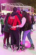 Manhattan, New York, U.S. 9th November 2013. Skate Guards in red jackets are with ice skaters, at Winter Village skating rink at Bryant Park that night.