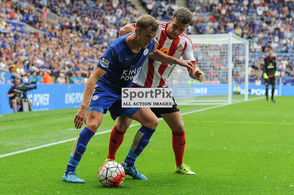 Andy King shields the ball from Adam Matthews late in the game (c) Simon Kimber | SportPix.org.uk