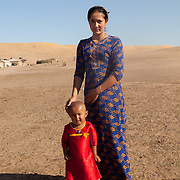A woman and child in a remote village, Karakum Desert, Turkmenistan