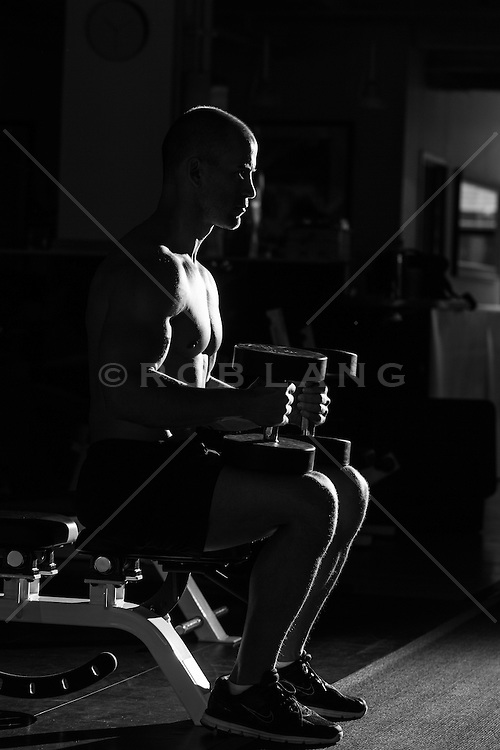 man with weights in a gym