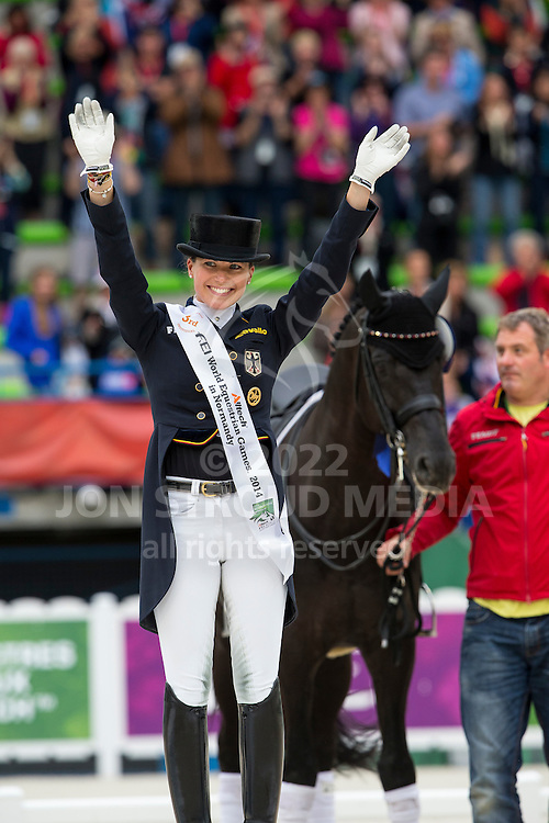 Kristina Sprehe and Desperados FRH bronze in the Grand Prix Special - Grand Prix Special Dressage - Alltech FEI World Equestrian Games&trade; 2014 - Normandy, France.<br /> &copy; Hippo Foto Team - Leanjo de Koster<br /> 25/06/14