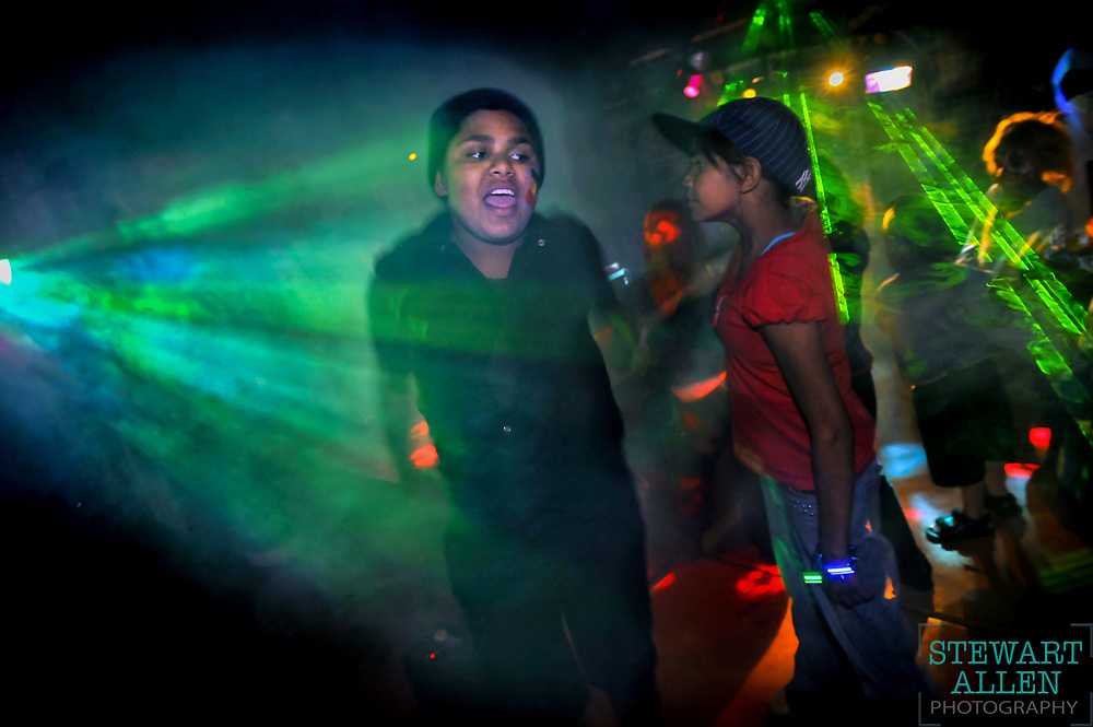 7. Best Picture Story<br /> Stewart Allen<br /> The Sunday Times<br /> Remote area policing. A young couple dance at a Police blue light disco in Laverton.