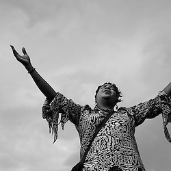 June 14, 2008 - Valerie Hash raises her hands in praise during a concert in Washington Park at the Juneteenth Celebration. The Juneteenth Celebration, which is the the oldest known celebration commemorating the end of slavery, was organized this year by The Southern Christian Leadership Conference.