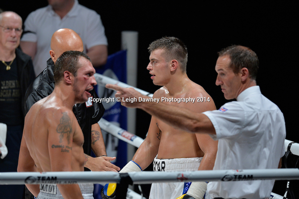 Referee instructs Olegs Fedotovs to return to his corner when he makes a challenge against the stoppage decision in a Light Heavyweight contest against Oscar Ahlin at the SSE Wembley Arena, London on the 20th September 2014. Sauerland Promotions. Credit: Leigh Dawney Photography.