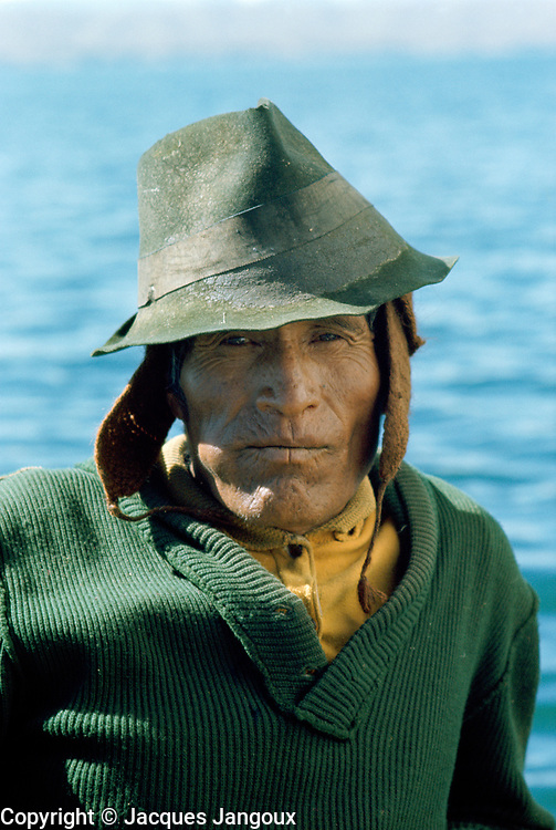 Aymara Indian fisherman chewing coca leaves swelling his cheek, Lake Titicaca, Bolivia