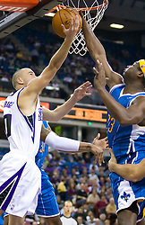 November 29, 2009; Sacramento, CA, USA;  New Orleans Hornets guard Devin Brown (23) blocks a shot from Sacramento Kings guard Sergio Rodriguez (10) during the fourth quarter at the ARCO Arena.  Sacramento defeated New Orleans 112-96.