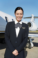 Stewardess Beside an Airplane