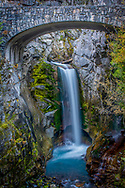 Christine Falls is a waterfall on Van Trump Creek in Pierce County, Washington. The falls are 69 feet feet high and are best known for having a famous rock bridge spanning the lower drop. The upper drop is 32 feet high and is almost impossible to film in tandem with the oft-photographed 37-foot lower tier. The lower tier is probably one of the most commonly photographed locations in the Mount Rainier area.