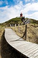 DEU, Germany, Schleswig-Holstein, North Sea,  Amrum island, dunes and plank roadway near Norddorf, the cross light Norddorf, lighthouse.<br /> <br /> DEU, Deutschland, Schleswig-Holstein, Nordseeinsel Amrum, Duenenlandschaft und Bohlenweg bei Norddorf, das Quermarkenfeuer Norddorf, Leuchtturm.