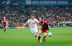 Andrew Robertson of Liverpool (R) vs Luka Modric of Real Madrid during the UEFA Champions League final football match between Liverpool and Real Madrid at the Olympic Stadium in Kiev, Ukraine on May 26, 2018.Photo by Sandi Fiser / Sportida
