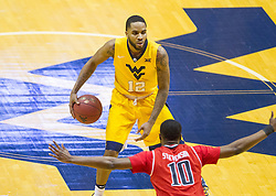 Feb 18, 2017; Morgantown, WV, USA; West Virginia Mountaineers guard Tarik Phillip (12) dribbles the ball during the first half against the Texas Tech Red Raiders at WVU Coliseum. Mandatory Credit: Ben Queen-USA TODAY Sports