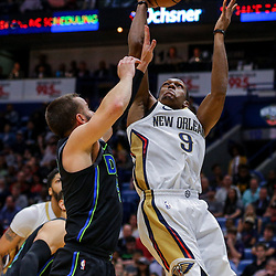 Mar 20, 2018; New Orleans, LA, USA; New Orleans Pelicans guard Rajon Rondo (9) shoots over Dallas Mavericks guard J.J. Barea (5) during the fourth quarter at the Smoothie King Center. Pelicans defeated the Mavericks 115-105. Mandatory Credit: Derick E. Hingle-USA TODAY Sports