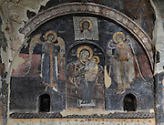 Fresco of the Virgin and child flanked by angels and with Christ's face on the shroud above, after restoration, on the wall of the portico of the Dormition of Saint Mary Cathedral Church, or Kisha Katedrale Fjetja e Shen Marise, built 1699, Voskopoje, Korce, Albania. The church contains frescoes by Theodor Anagnost and Sterian from Agrapha in Greece, and the large icons in the iconostasis were painted 1703 by Constantine Lemoronachos. Picture by Manuel Cohen