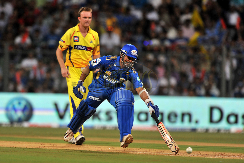Sachin Tendulkar captain of Mumbai Indians runs to complete a run during match 25 of the the Indian Premier League ( IPL ) Season 4 between the Mumbai Indians and the Chennai Superkings held at the Wankhede Stadium, Mumbai, India on the 22nd April 2011..Photo by PalPillai/BCCI/SPORTZPICS.