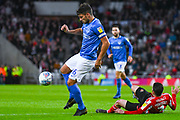 Gareth Evans of Portsmouth (26) fouls Bryan Oviedo of Sunderland (3) during the EFL Sky Bet League 1 first leg Play Off match between Sunderland and Portsmouth at the Stadium Of Light, Sunderland, England on 11 May 2019.