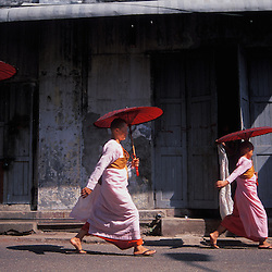 Burmese buddhist nuns make their daily rounds in Myanmar's capital city of Yangon.