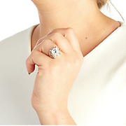 Who says romance is dead? British jeweller creates 'fidelity' engagement ring that doubles as a TRACKING device to allow men to keep tabs on their fiancees<br /> <br /> Brides who say 'yes' could be agreeing to a lot more than they bargained for, with the unveiling of a new engagement ring that also doubles as a tracking device.<br /> British jeweller, Steve Bennett, has built the first prototype, which may look like any other diamond ring, but has the discreet addition of a bluetooth chip.<br /> It means jealous spouses will now be able to keep tabs on their significant other - that is, if their partner actually agrees on wearing one.<br /> <br /> Smaller than a thumbnail, the sophisticated GPS tracking technology is slotted behind the jewel of the ring, which has currently been designed in two different prototypes.<br /> The latest development in the wearable technology trend, one design boasts a sizable square cut diamond with an eight-prong silver setting, while the other is composed of a violet marquise-cut diamond with an unusual square setting.<br /> <br /> <br /> But what both prototypes have in common, is that they will report the location of the ring at all times.<br /> Bennett, the CEO and founder of online jeweller, Gemporia, says the main purpose of the ring is for theft and loss protection.<br /> For jealous types, however, it also gives information into where its wearer is.<br /> <br /> The piece of jewellery will be marketed by Gemporia as their 'fidelity ring'.<br /> While not many people would be elated at the prospect of their partner knowing their exact location at all times, Bennett insists that the benefits by far outweigh any doubts.<br /> He said: 'The idea came to me as I was thinking of ways to ensure the safe-keeping of jewellery. Our collections include some highly valuable pieces and some added insurance is of course always welcome.<br /> 'However, the most important factor was witnessing the devastation of people who have misplaced thei