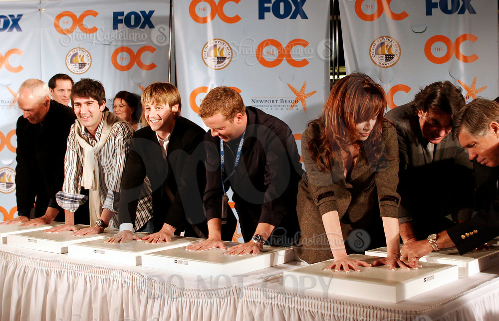 Oct 28, 2004; Newport Beach, CA, USA; Cast & Producers of the FOX hit TV show 'The OC' visited the Balboa Penninsula in Newport Beach to get a Key to the City and be immortalized in cement with thier hand prints to be placed at the enterance to the Historic Balboa Pavillion. (L-R) ALAN DALE, MELINDA CLARKE, PETER GALLAGHER, JOSH SCHWARTZ, MCG, BENJAMIN MCKENZIE. Mandatory Credit: Photo by Shelly Castellano/ZUMA Press.