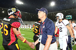 10.07.2011, Tivoli Stadion, Innsbruck, AUT, American Football WM 2011, Group A, Germany (GER) vs United States of America (USA), im Bild shakehands between Matthias Eck (Germany, #26, DB) and Mel Tjeerdsma (USA, Head Coach) after the game // during the American Football World Championship 2011 Group A game, Germany vs USA, at Tivoli Stadion, Innsbruck, 2011-07-10, EXPA Pictures © 2011, PhotoCredit: EXPA/ T. Haumer