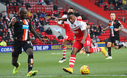 Callum Harriot takes on Nyron Nosworthy during the Sky Bet Championship match between Charlton Athletic and Blackpool at The Valley, London, England on 13 December 2014.