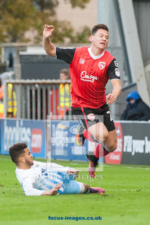 Paul Mullin of Morecambe is tackled by Dion Kelly-Evans of Coventry City during the first round FA Cup match at the Globe Arena, Morecambe<br /> Picture by Matt Wilkinson/Focus Images Ltd 07814 960751<br /> 06/11/2016
