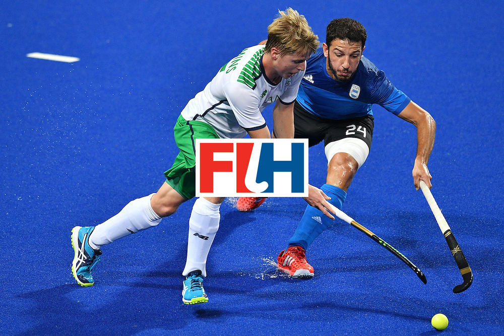 Argentina's Manuel Brunet (R) and Ireland's Kirk Shimmins vie during the mens's field hockey Ireland vs Argentina match of the Rio 2016 Olympics Games at the Olympic Hockey Centre in Rio de Janeiro on August, 12 2016. / AFP / Carl DE SOUZA        (Photo credit should read CARL DE SOUZA/AFP/Getty Images)