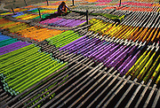 Drying freshly dyed and printed sarees on elevated bamboo racks, Pali, Rajasthan, India