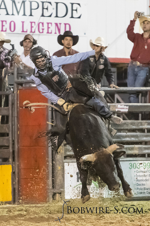Bull rider Jake Smith rides Summit Pro Rodeo's Battle Won in the second performance of the Elizabeth Stampede on Saturday, June 2, 2018.
