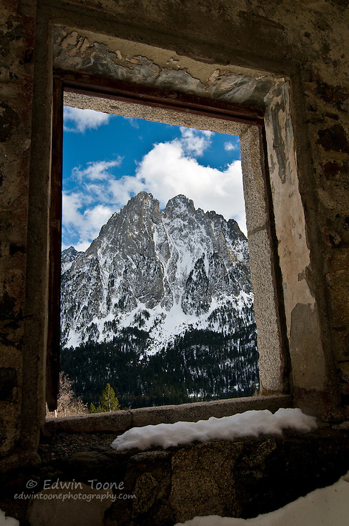 Mountain view with snow from an abandoned building.