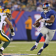 Victor Cruz, New York Giants, in action after a pass reception during the New York Giants Vs Green Bay Packers, NFL American Football match at MetLife Stadium, East Rutherford, New Jersey, USA. 17th November 2013. Photo Tim Clayton