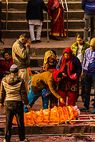 Bodies are first prepared for cremation before being carried to the funeral pyres at the Pashupatinath Temple, a Hindu temple along the Bagmati River in Kathmandu, Nepal. The Bagmati is equally as sacred to Nepalese as the Ganges is to Indians. Hindus come to be cremated here.