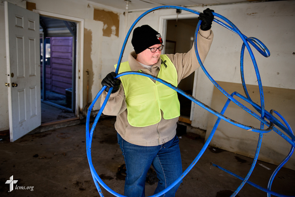 Jennifer McBurney of LCMS Communications works with other volunteers from the International Center of The Lutheran Church–Missouri Synod, LCMS Disaster Response, New Beginnings Lutheran Church in Pacific, Mo., and Missouri representatives of the Southern Baptist Convention Disaster Relief, during a cleaning event at a flooded home in Fenton on Thursday, Jan. 14, 2016. LCMS Communications/Erik M. Lunsford